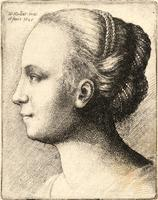 Young woman with hair bound with pearls