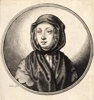 Woman wearing a dark hood