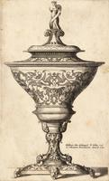 Ornate goblet on feet of masks